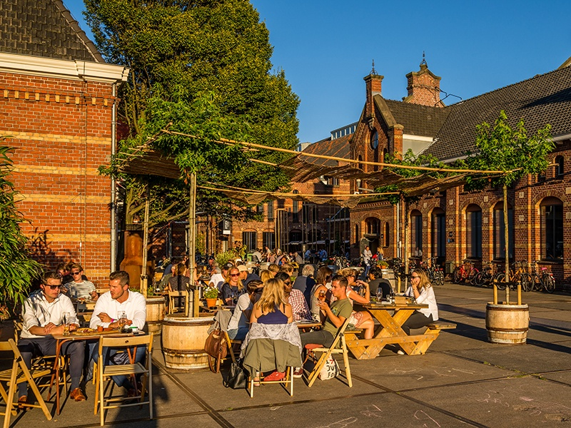 A television studio, jazz club, and several restaurants and shops stretch along The Street, or Pazzanistraat, within Westergasfabriek. Photograph: Arjen Veldt