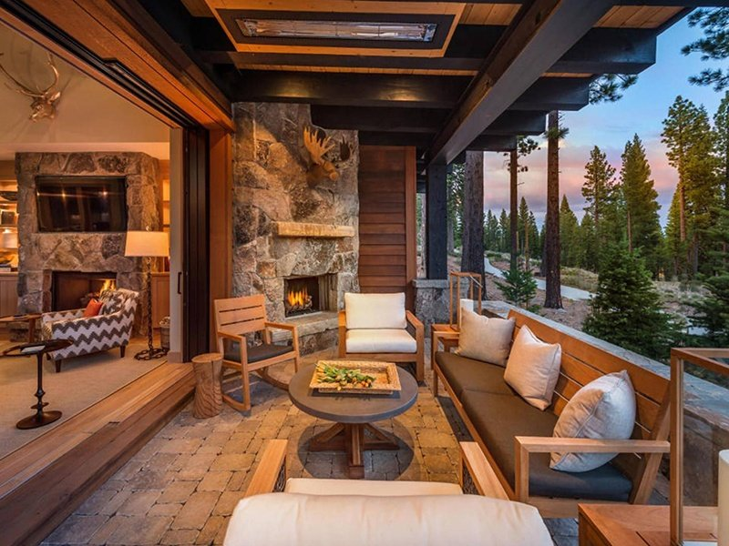 Generous outdoor decking and windows that frame nature at all angles help to create an indoor-outdoor feel.