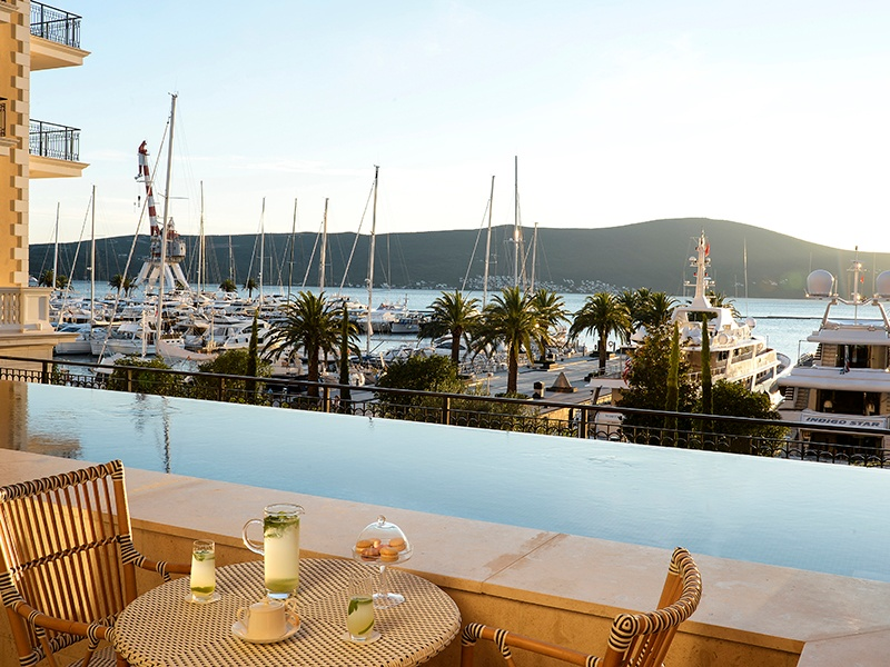 The Regent Porto Montenegro's infinity-edge pool gives way to a magnificent view of the marina and its luxurious visiting vessels.