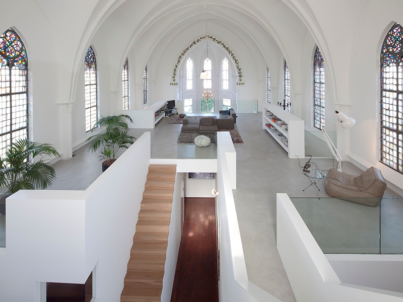 In order to maintain St Jakobus Church's lofty ceilings, Zecc Architects added modular floors and stairways to zone the space within. Photograph: Frank Hanswijk