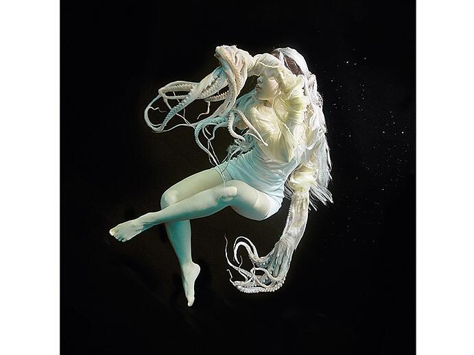 The Korean mermaids of Jeju Island venture into the sea without breathing equipment, scouring the seabed for abalone, octopus, and other seafood. Zena Holloway interprets this legacy with her <i>Flowers for Jeju</i> series of images. Photograph: ©Zena Holloway