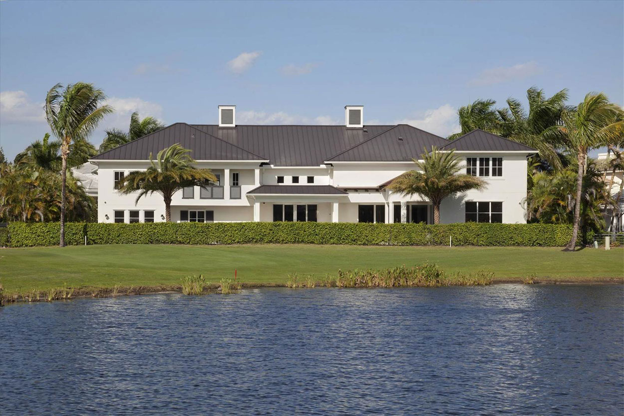 This luxurious West Indies-inspired estate overlooks a scenic lake on the course at St. Andrews Country Club, which is ranked among the distinguished five-star Platinum Clubs of America.