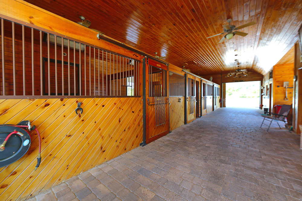 The custom-built, innovative barn is equipped with the latest technology, four stalls, a tack room, utility room, a full bath and much more.
