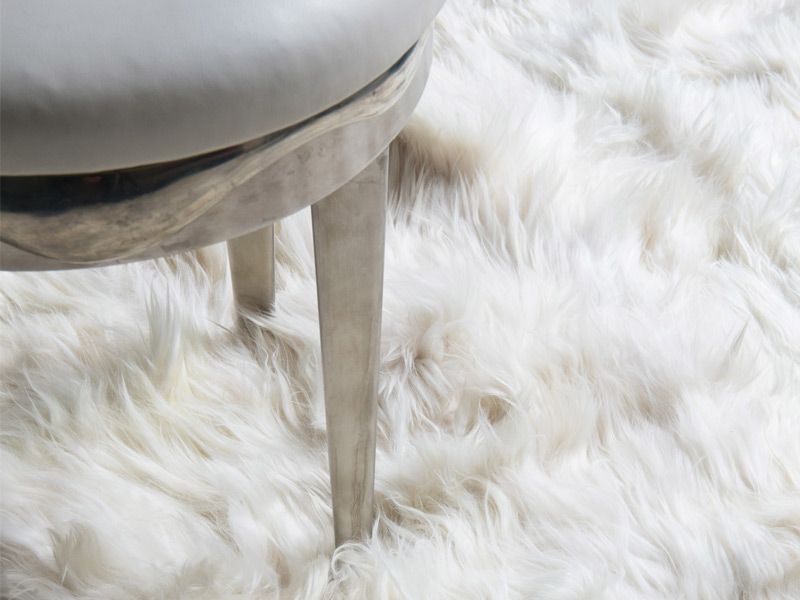 Alpacas are renowned for their silky and versatile fur, which is ideal for weaving rugs like the one pictured above. Photograph: The Rug Company. Image, top: The White Company