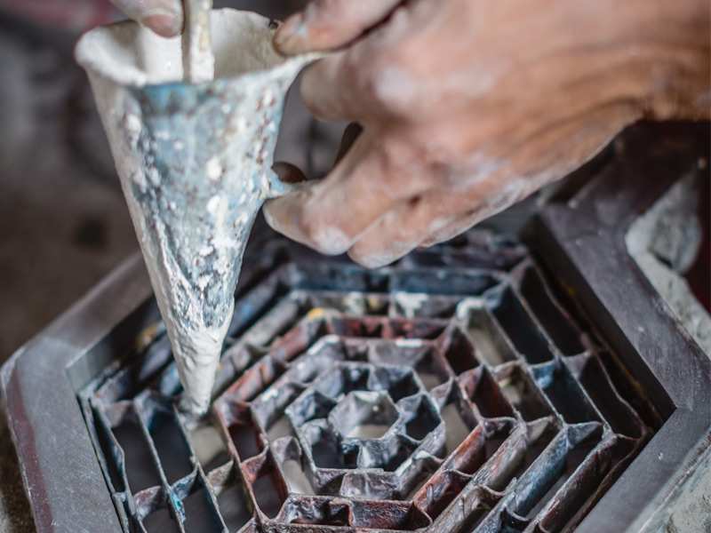 Many of the artisan craftsmen at Popham Design have more than two decades of experience in hand-crafting tiles. Photograph: Chris Terry