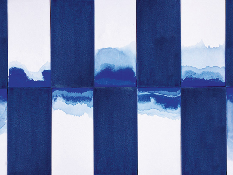 """Tiles in the Clé Watermark series are """"dipped, stroked, stained, and washed"""" with indigo pigment before being fired."""