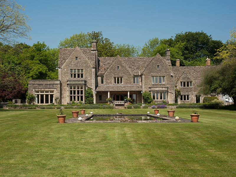 The impressive Grade-II listed Warrens Gorse House was designed in 1922 by Norman Jewson, an architect and craftsman of the Cotswold group of the Arts and Crafts movement.