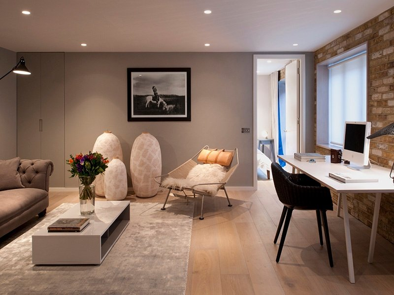 Thomas Griem of TG-Studio designed this bespoke home office for a client who wanted the space to flow naturally from the living area. Discreet storage has been built into the wall to minimise clutter and preserve the elegant look of the room.