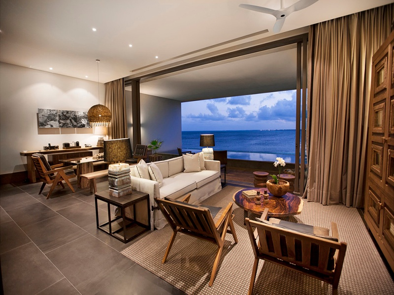 The suites and villas of the NIZUC Resort & Spa in Cancún elegantly mix modern luxury with ancient Mayan style.