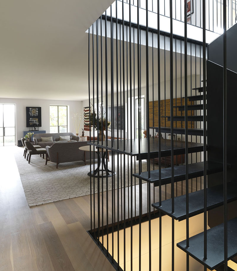 The extraordinary design of the one-of-a-kind metal staircase and barred stairwell make a dramatic standout feature in the entrance hall. Photograph: Anson Smart