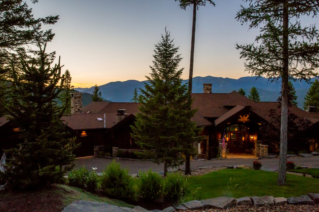 <b>US$2,750,000<br/>5 Bedrooms, 6,561 sq. ft.</b><br/>This beautiful home is situated in the exclusive, gated Grouse Mountain Estates, with outstanding views of the golf course, Whitefish Lake, and Glacier National Park. The home displays high-end finishes throughout and offers impressive amenities including a game room, wine cellar, cigar bar, 1,000-square-foot deck, and landscaped garden.