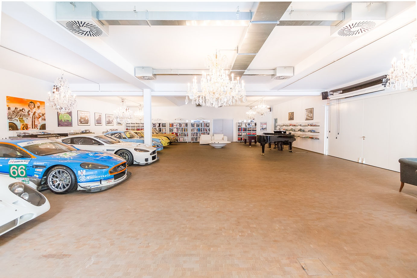 This Vienna estate has a trove of luxurious amenities, including an underground, eight-car showroom complete with crystal chandeliers, a grand piano, and an adjoining workshop with lifting ramp.