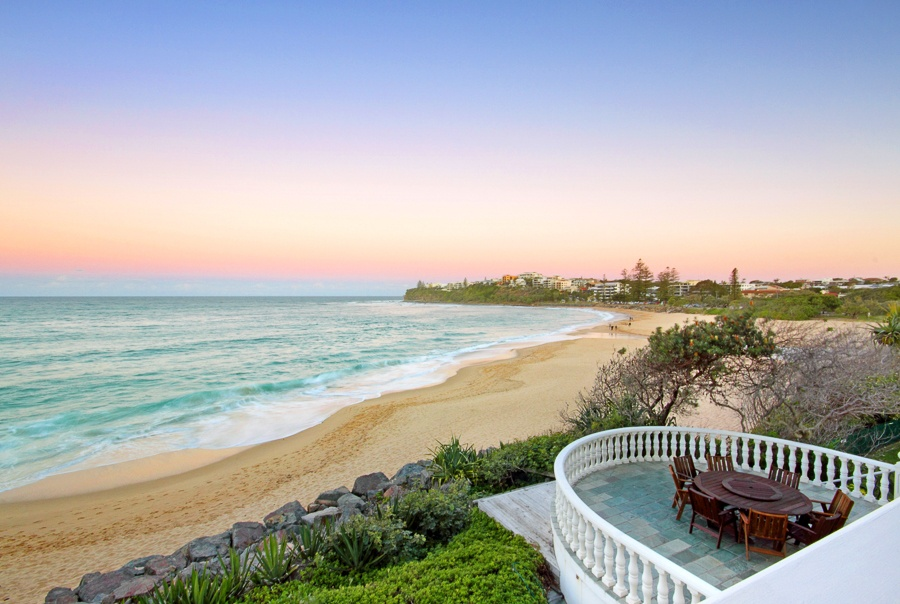 This five-bedroom estate situated on protected Moffat Beach is an ideal Queensland retreat located within five minutes of downtown cafes and shops on a pristine beach for swimming, sailing, and surfing.