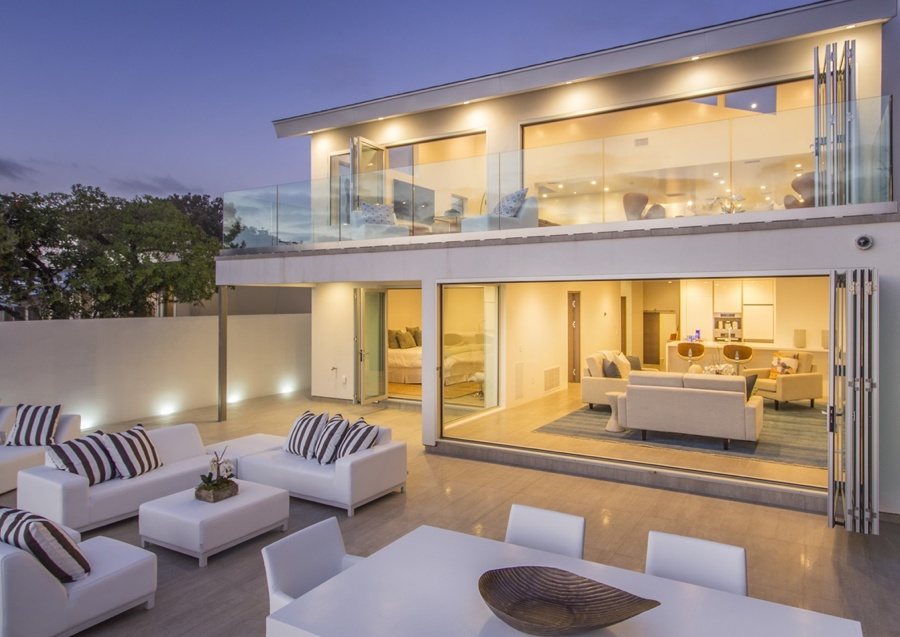 Expansive open spaces, vaulted ceilings, and wall-to-wall disappearing glass doors afford unparalleled ocean views.