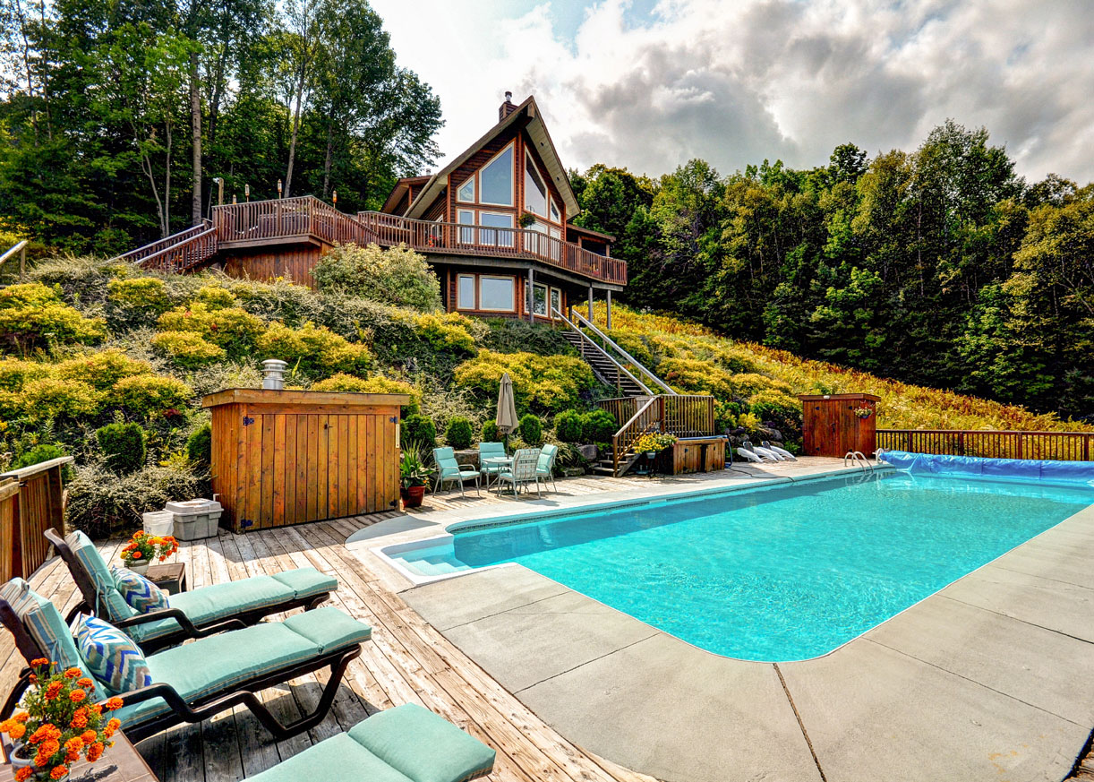 <b>C$1,590,000<br/>5 Bedrooms, 2,640 sq. ft.</b><br/>Fiddlehead Mountain is truly an exceptional 120-acre private mountainside estate located just minutes away from Huntsville. This 5 bedroom, 3 bath chalet has an open concept gourmet kitchen/dining area, wood burning fireplace in a light filled living room, along with a large pond for skating, 50 ft. swimming pool, and hot tub.