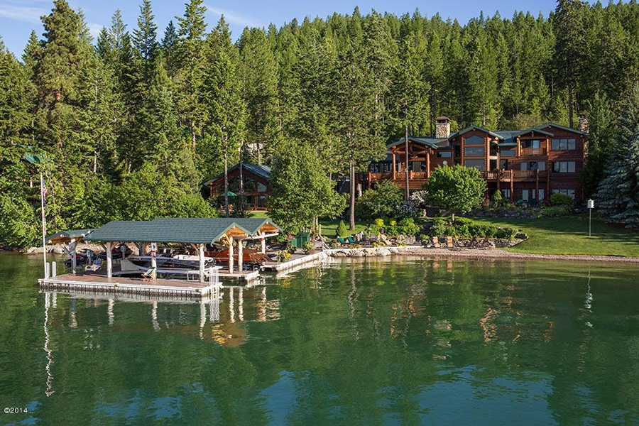 A turn-key Flathead Luxury Lake home on Conrad Pt with 200ft of pebble beach.