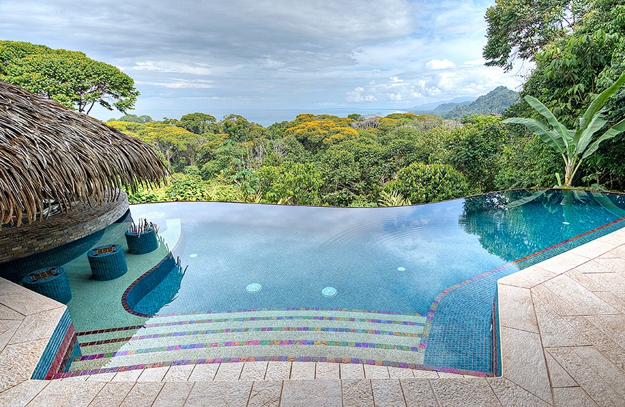 This Costa Rican property's swim-up bar with thatched cabana provides dreamlike views of the adjacent jungle canopy and nearby ocean.