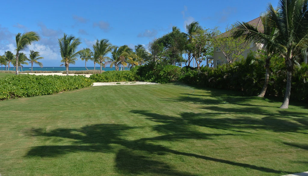 The sensational two-story property also features a swimming pool and gazebo, and is steps away from a white-sand beach.