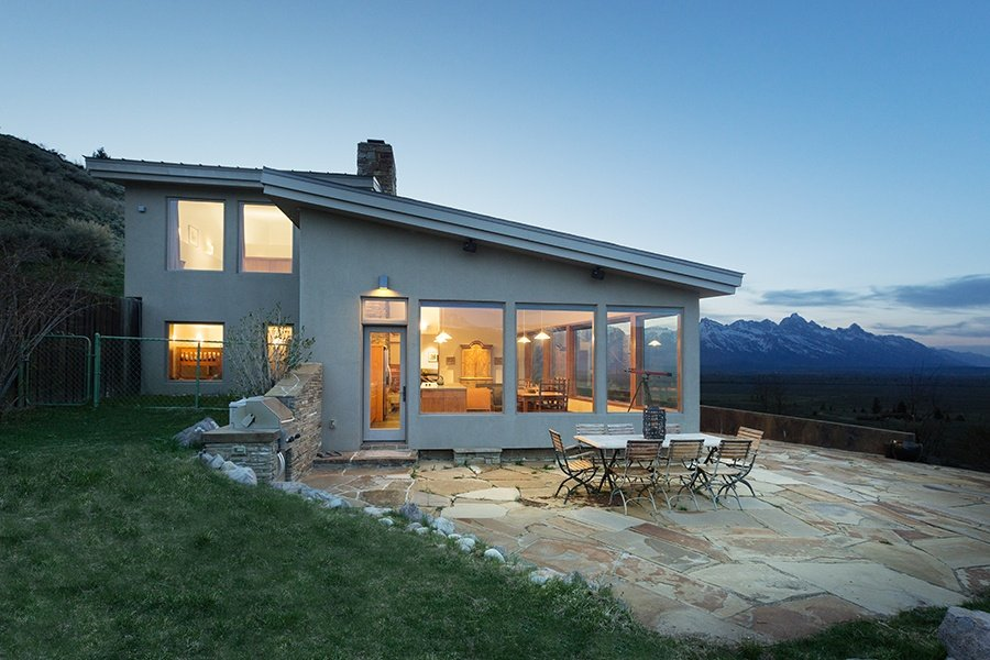 Spectacular views from the patio of this Jackson Hole, Wyoming, retreat are the ultimate backdrop for an evening under the stars.
