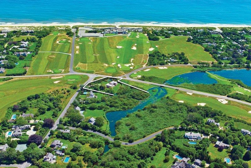 This exceptional 2.5+/- acre property is surrounded on three sides by East Hampton's prominent Maidstone Club.