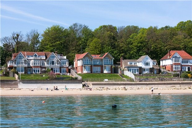 <b>5 Bedrooms, 2,699 sq. ft.</b><br/>A spectacular seafront home, built in 2009 to maximize its glorious Solent views within the sought-after and tranquil Seagrove Bay. A huge ground floor family room provides an ideal open space for family time, to socialize and relax together. Large bay picture windows with fitted seating and double doors opening on to a large elevate terrace and onto the lawned gardens from which the ever-changing views across The Solent can be appreciated from direct access onto the beach. The first floor boasts four well fitted light and generous double bedrooms (three of which are en suite).
