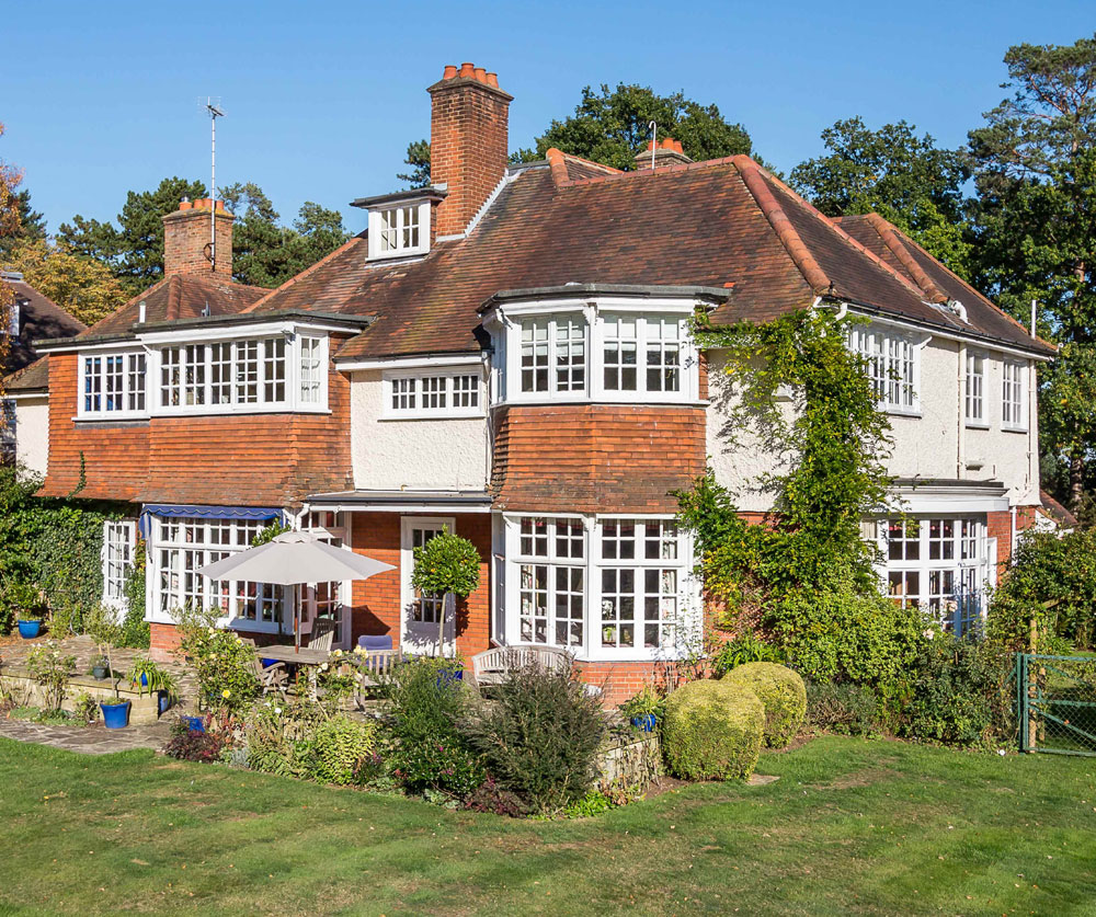 The beautifully presented property dates back to 1905 and has been lovingly maintained by the current owners. The house offers 4,852 square feet of grandly proportioned interiors with eight bedrooms, an impressive wood-paneled reception hall, and beautiful reception rooms.