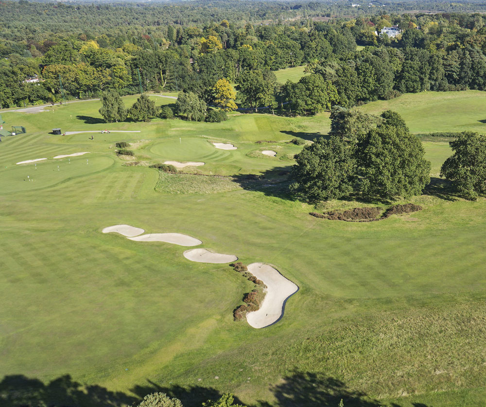 The property overlooks the historic Sunningdale golf course, one of England's finest courses, and even has a private gate leading out to the ladies course. The west-facing grounds are an added highlight; planted with specimen shrubs and trees, they include a paved patio area and heated swimming pool.
