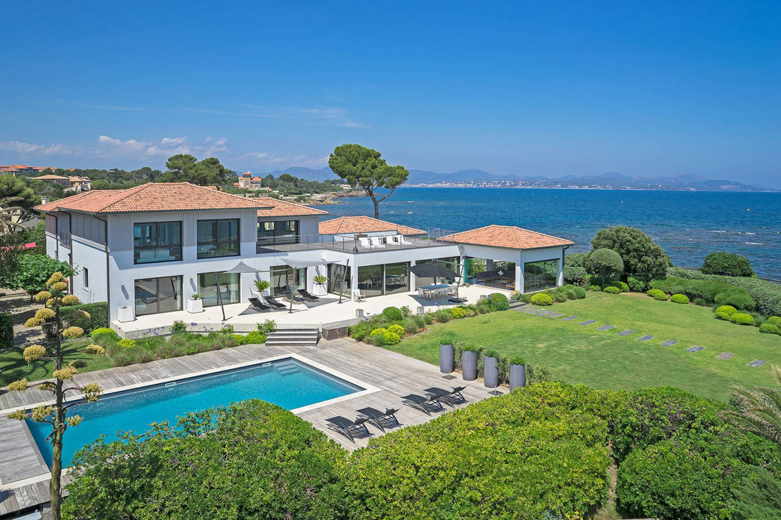 <b>7 Bedrooms, 5,242 Sq. Ft.</b><br/>This amazing contemporary colonial-style property is one of three exclusive waterfront villas sited in a secluded gated domain and has direct access to the sea.