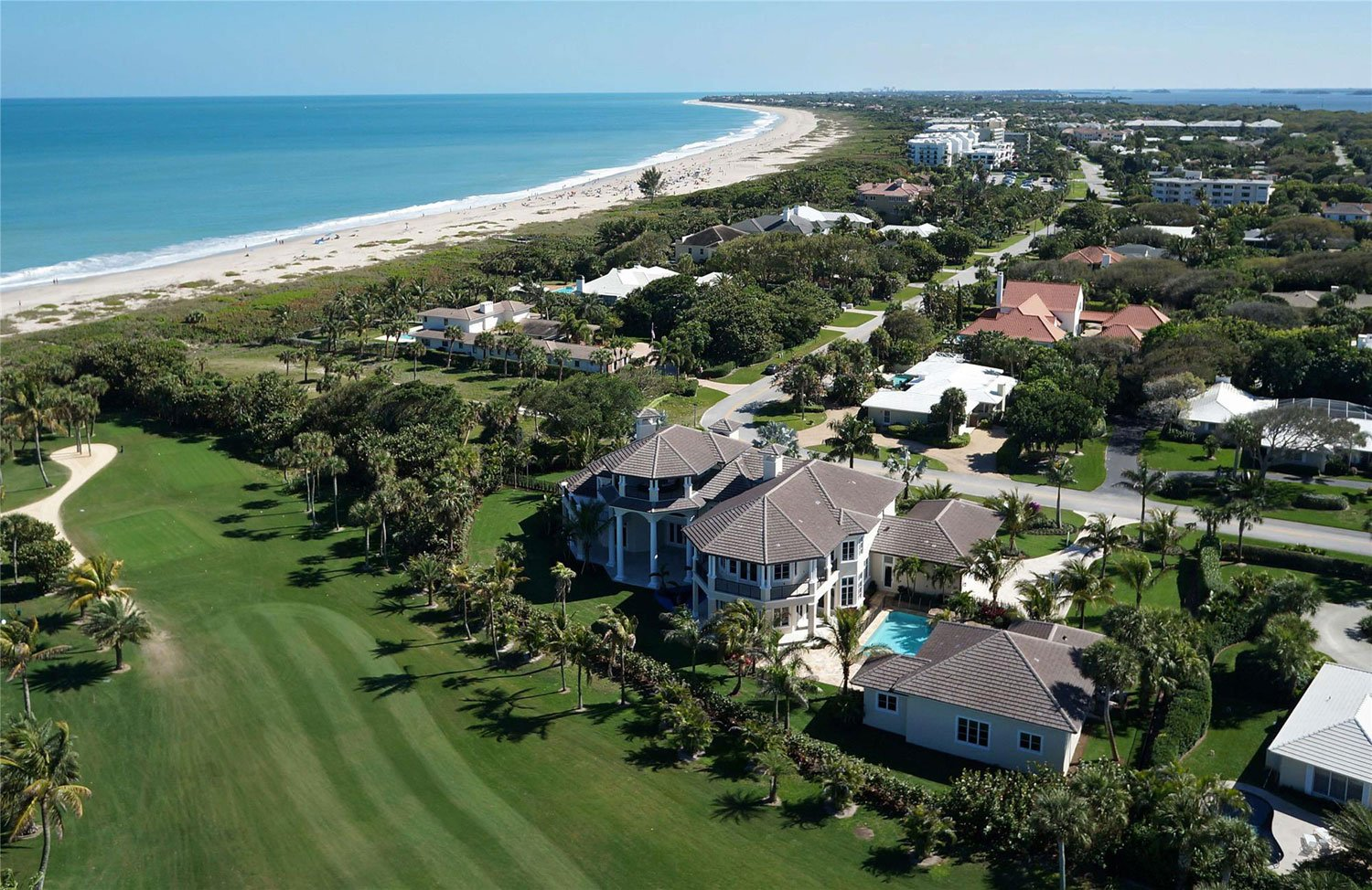 This spectacular British West Indies-inspired compound is situated on 252 feet of frontage on the oceanfront fairways at Riomar Country Club.