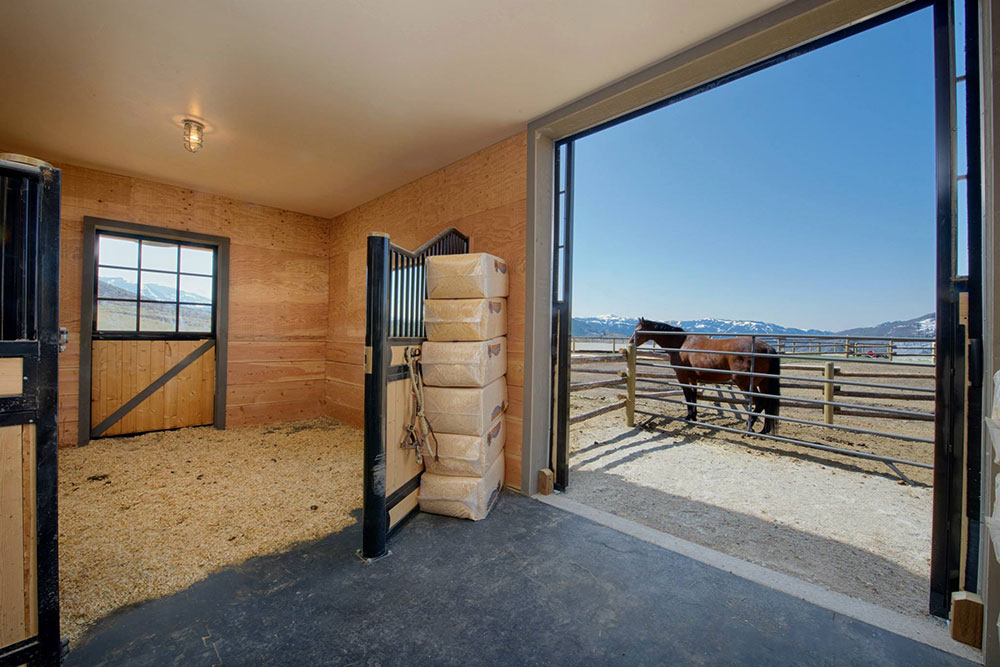 The estate features an 1,800 square foot heated barn with four horse stalls, tack room, six automatic horse waterers and horse feeders, two paddock corals, and outside horse cross tie fence.