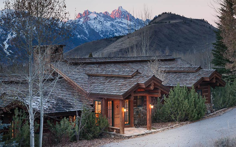 Nestled on 10 acres, this classic Rocky Mountain retreat serves up stunning views of the Teton Range and makes a great home base for outdoor activities from cycling to hiking.