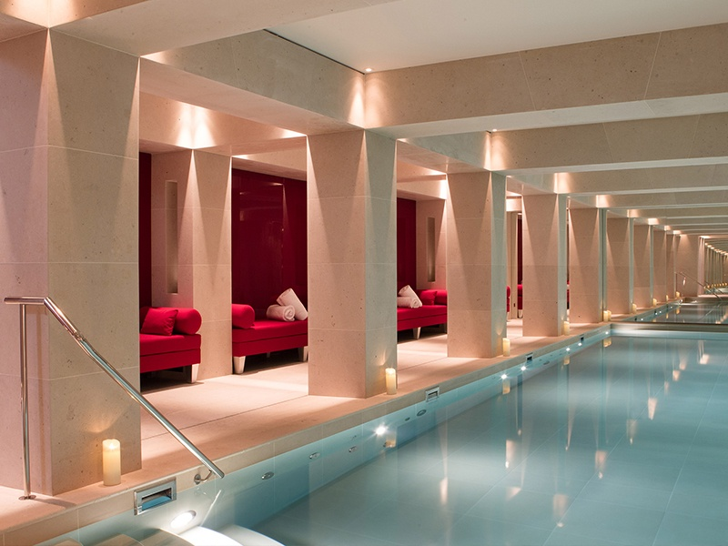 La Réserve Spa's gently candlelit indoor pool is the ultimate place to relax before or after a bespoke Nescens beauty treatment.
