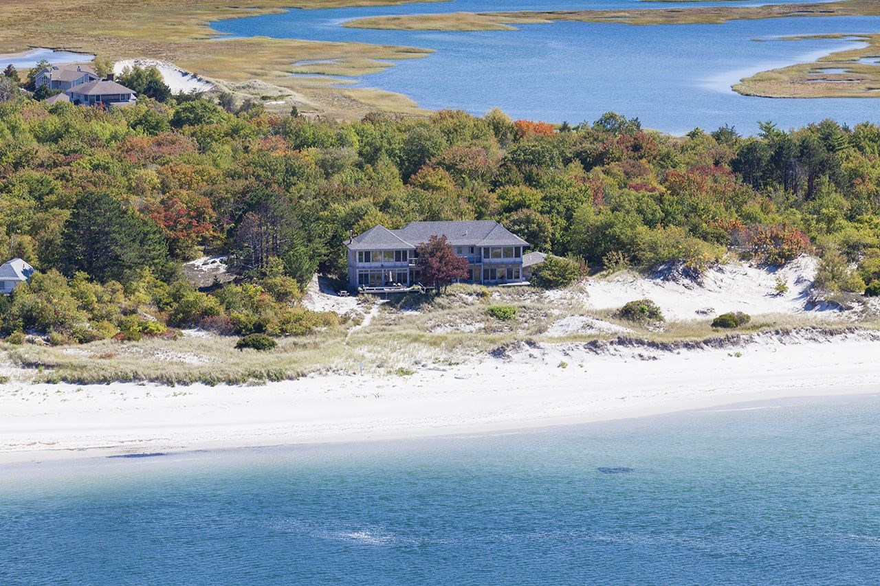 <b>5 Bedrooms, 4,921 sq. ft.</b><br/> A rare opportunity to own a spectacular beachfront home located on Wingaersheek Beach in Gloucester, prized for its quiet privacy, unspoiled charm, and sweeping views over conservation land, this property features generous space for entertaining and outdoor oceanfront living including a potential mooring, as well as kayaking, swimming, and dramatic sunsets. Nestled in the dunes overlooking Crane Beach, the Essex River, and the Atlantic Ocean, this shingle-style contemporary built in 2007 is the ultimate in beachfront living with magnificent ocean-facing outdoor decks.