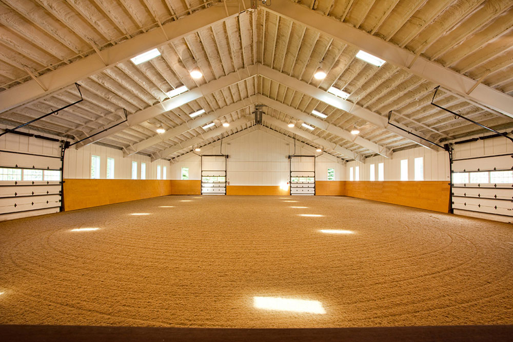 A state-of-the-art facility, the year-round property comprises a heated indoor ring with sky lights, custom riding surface for indoor and outdoor arenas, stabling for multiple horses, individual paddocks, and more.