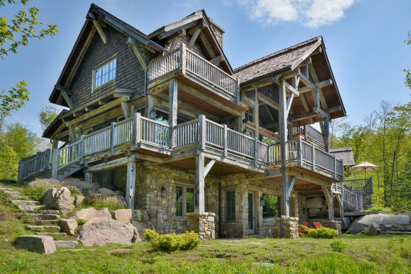 A rustic five-bedroom home in Mont Tremblant on the shores of Lac Desmarais