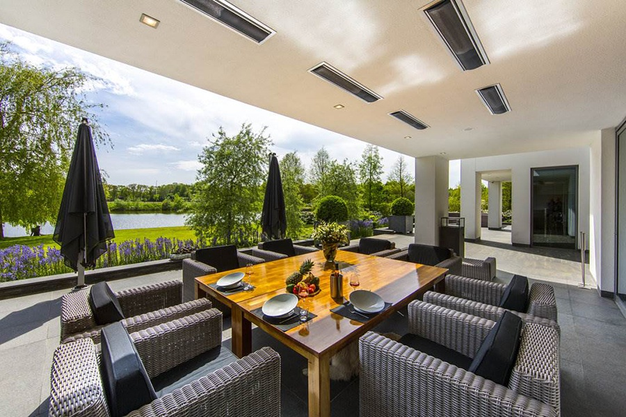 This covered terrace offers comfortable seating for long summer evenings of fine dining and good company.