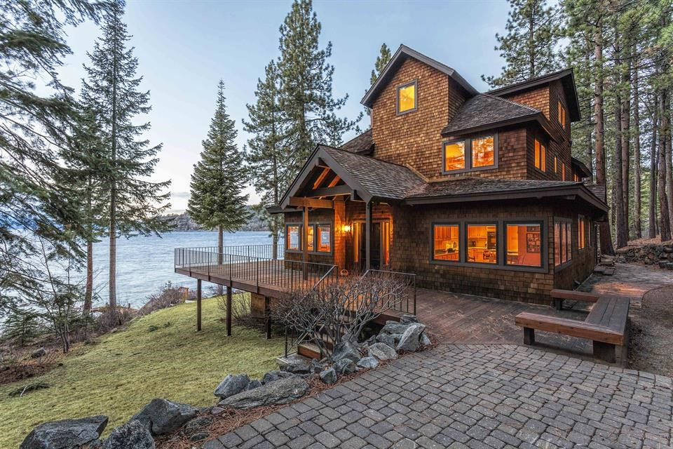 <b>7 Bedrooms, 4,759 Sq. Ft.</b><br/>A gently rolling lawn adjoins 400-plus-feet of shoreline with a private deep-water pier and boat lift. This seven-bedroom home is sited on 3.7-acres and enjoys spectacular views and privacy.