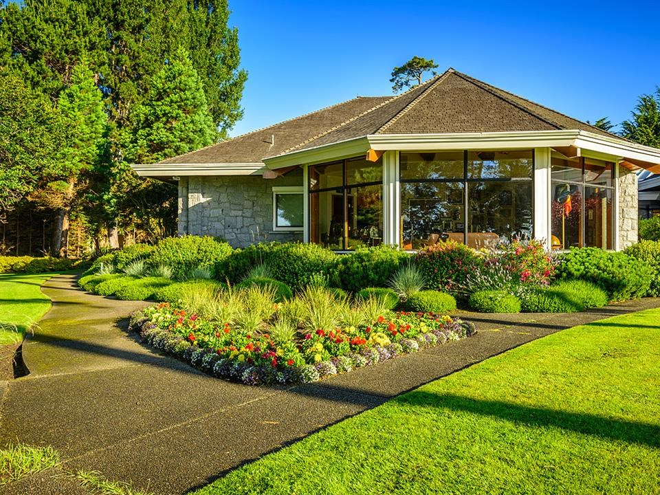 The professionally landscaped grounds are absolutely spectacular. Showcasing a variety of trees, shrubs, bushes and flowers both native and exotic, the gardens are enhanced by a water feature by the entry gates, and year-round colour and interest.