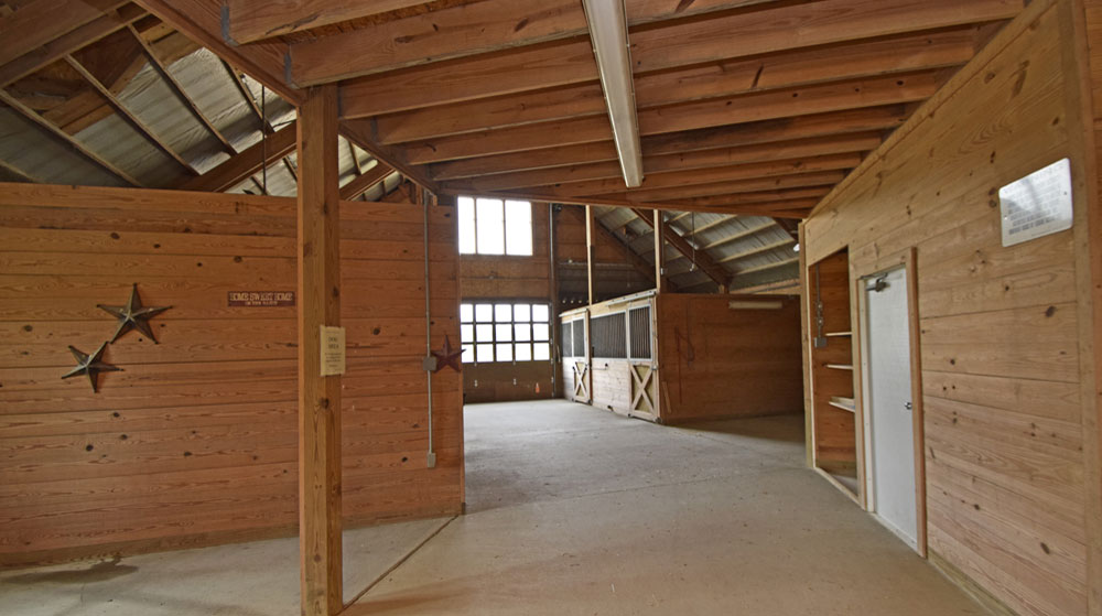 The complex features an 11-stall stable attached to an indoor riding arena offering premium amenities for your horse riding enjoyment.