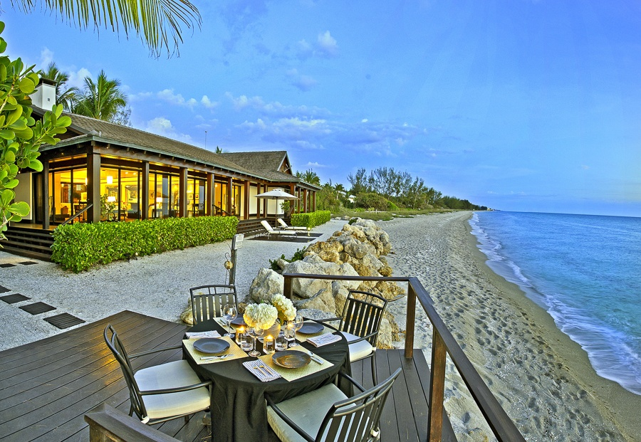 This tranquil, five-bedroom retreat on the Gulf of Mexico bordering Siesta Key combines a quintessential Florida setting with sleek architecture and a Japanese-inspired landscaped garden. Situated on two acres, this home has floor-to-ceiling glass doors, providing a spectacular panoramic water view, and eye-catching Polynesian touches in its interior.