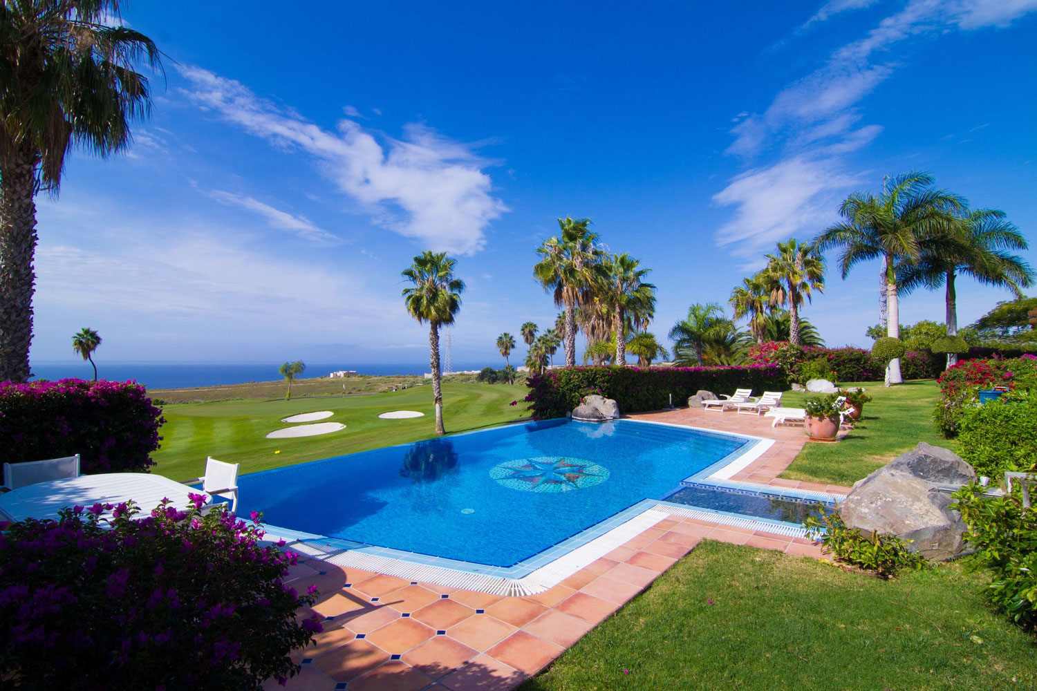 This elegant villa is situated on the premier plot overlooking the greens of the Golf Costa Adeje club in southern Tenerife. In addition to incredible golf and sea views, the property offers luxurious living and an environment of total privacy.