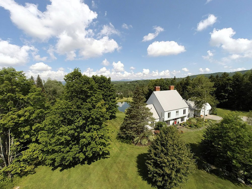 <b>US$925,000<br/>5 Bedrooms, 4,513 sq. ft.</b><br/>With all the charm of a Vermont farmhouse, this exceptional property boasts breathtaking views of Mount Mansfield and one of the finest locations in Stowe. The private 4.2-acre landscaped grounds are enhanced with a pond and waterfall. Inside, a country kitchen opens to a family room with just one of the five Count Rumford fireplaces, and a multi-sided sunroom is spectacular for summer entertaining. The home also comes complete with most of the furnishings, equipment, and new appliances.