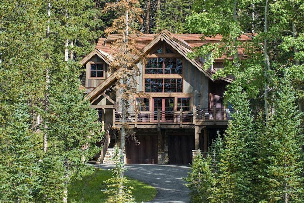 <b>4 Bedrooms,  3,514 sq. ft.</b><br/>This rare assemblage of two estate ski lots totals 2.7 private, lushly forested acres bordering US Forest Service land. Located below and out of sight from the primary residence is a quaint, lodge-like residence with an exterior of native stone, vertical cedar siding with rustic Corten steel accents.