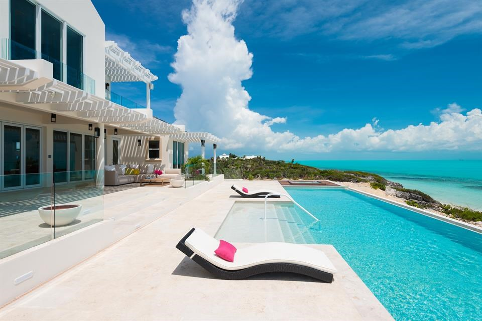 <b>6 Bedrooms,  5,960 sq. ft.</b><br/>Live a life of spectacular luxury within this magnificently constructed estate on Long Bay Beach, Providenciales. Villa Isla is built on one of the higher beach dunes and comprises five beachfront bedrooms, six bathrooms, and 5,960 sq. ft. of living space. Built to very high specifications by one of the island's renowned builders, this villa boasts grand architectural features and fine finishes throughout.