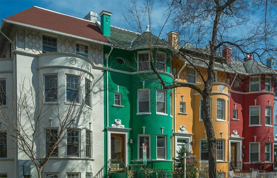 """Known as the """"Green House,"""" this 1910 property, boasting four finished levels, four fireplaces, and a gourmet kitchen, sits on Rainbow Row, a street perfect for biking along."""