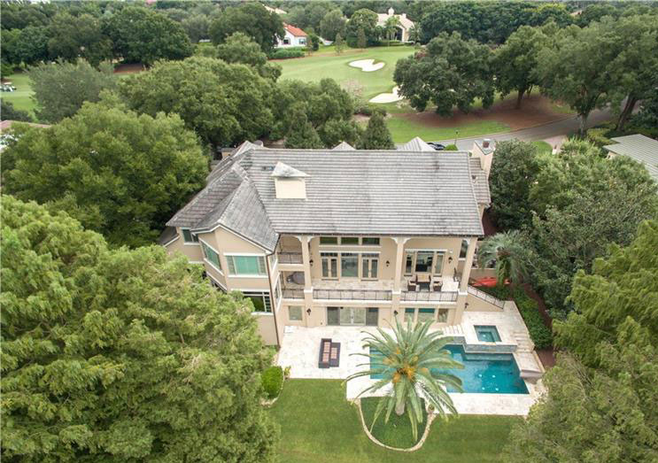 This beautiful three-story home is located in the prestigious Isleworth Golf & Country Club, near Orlando, in Windermere, Florida. The property has incredible views across Lake Butler and directly fronts the 15th hole of Isleworth's championship golf course.