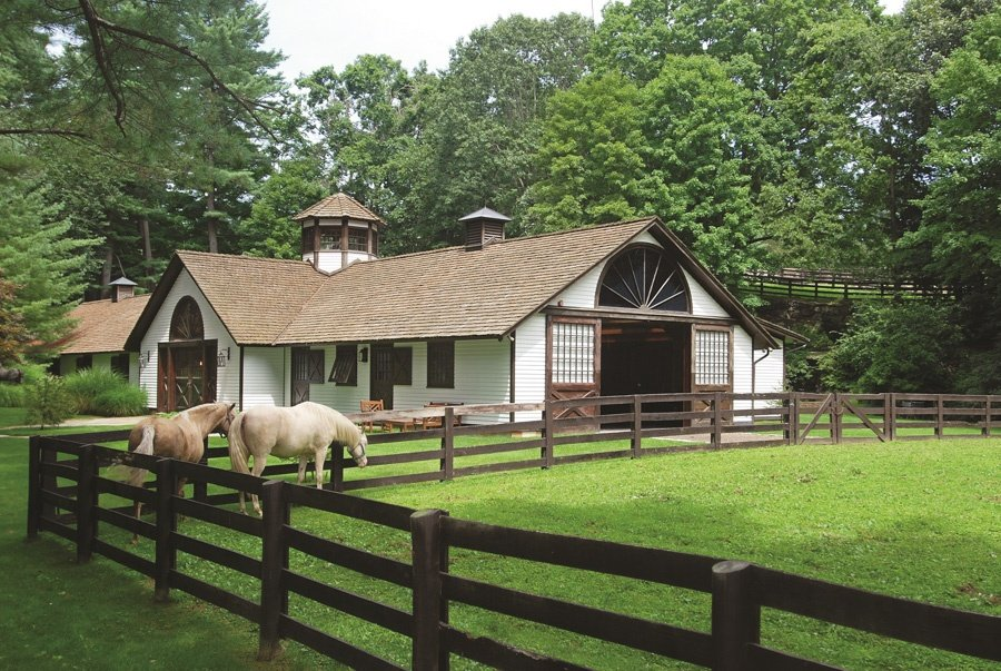 Set against a scenic landscape of verdant countryside, a classic Tudor-style mansion and pristine state-of-the-art equestrian facilities offer the ultimate haven of privacy and relaxation.