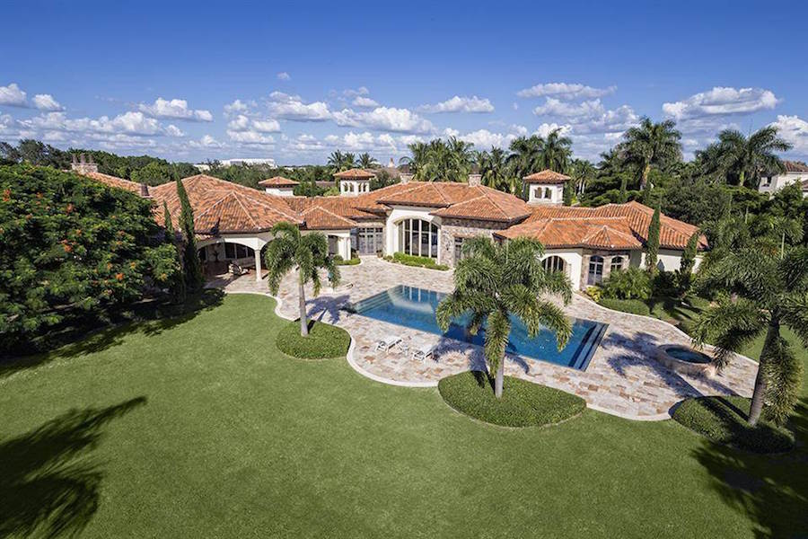 Featuring exclusive access to one of South Florida's best golfing communities, this luxurious estate with vast manicured gardens offers all the amenities of the Bay Colony Golf Club, plus privacy and seclusion.